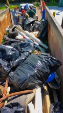 P1000838 dumpster full of garbage 180